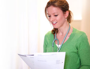 Nurse reading patient notes